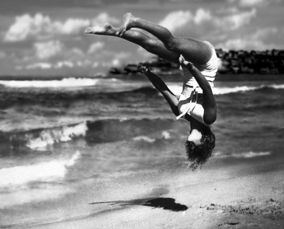 Peggy Bacon in mid-air backflip, Bondi Beach, 1937.